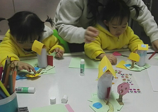Twins making houses